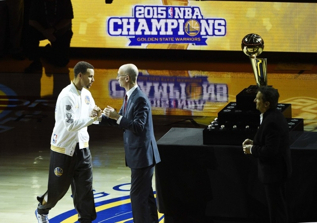Oct 27, 2015; Oakland, CA, USA; NBA commissioner Adam Silver congratulates Golden State Warriors guard Stephen Curry (30) before the game against the New Orleans Pelicans at Oracle Arena. Mandator ...