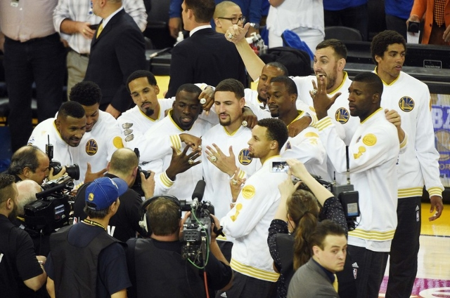 Oct 27, 2015; Oakland, CA, USA; The Golden State Warriors celebrate receiving their 2014-2015 NBA Championship rings before the game against the New Orleans Pelicans at Oracle Arena. Mandatory Cre ...