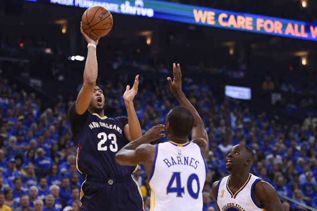 October 27, 2015; Oakland, CA, USA; New Orleans Pelicans forward Anthony Davis (23) shoots the basketball against Golden State Warriors forward Harrison Barnes (40) during the first quarter at Ora ...