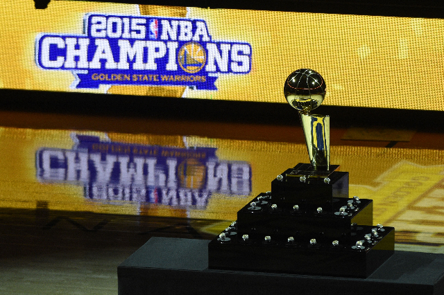 October 27, 2015; Oakland, CA, USA; The championship trophy and championship rings are on display before the game between the Golden State Warriors and the New Orleans Pelicans at Oracle Arena. Ma ...