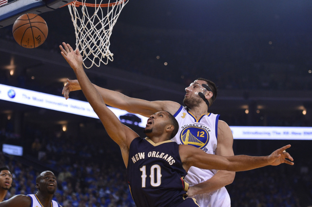October 27, 2015; Oakland, CA, USA; Golden State Warriors center Andrew Bogut (12) blocks the shot of New Orleans Pelicans guard Eric Gordon (10) during the first quarter at Oracle Arena. Mandator ...