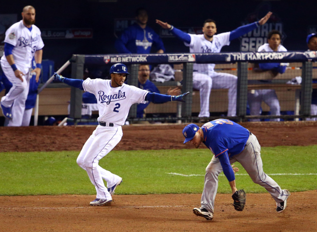 Oct 27, 2015; Kansas City, MO, USA; Kansas City Royals shortstop Alcides Escobar (2) reacts after reaching on a throwing error to New York Mets first baseman Lucas Duda (21) in the 14th inning in  ...