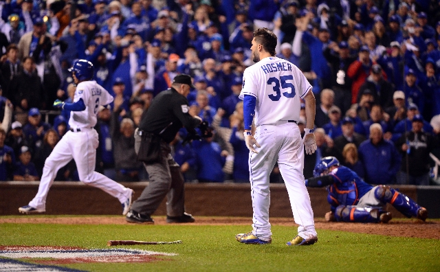 Oct 27, 2015; Kansas City, MO, USA; Kansas City Royals first baseman Eric Hosmer (35) celebrates after driving in shortstop Alcides Escobar (2) for the winning run with a sacrifice fly against the ...
