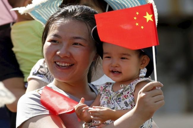 . China's ruling Communist Party said on October 29, 2015 it will ease family planning restrictions to allow two children for all couples. (Reuters/Kim Kyung-Hoon/Files)