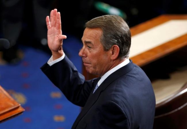 Outgoing House Speaker John Boehner, R-Ohio, waves after addressing colleagues during the election for the new Speaker of the U.S. House of Representatives in the House Chamber in Washington, Oct. ...