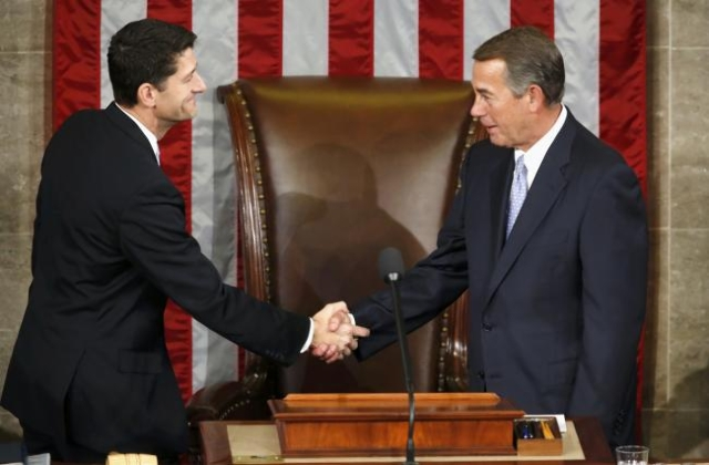 Outgoing House Speaker John Boehner, R-Ohio, right, greets incoming House Speaker Paul Ryan during the election for the new Speaker of the U.S. House of Representatives on Capitol Hill in Washingt ...
