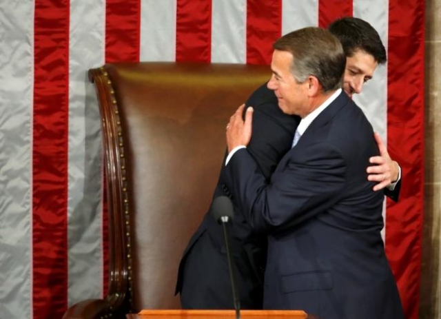Outgoing House Speaker John Boehner, R-Ohio, right, embraces incoming House Speaker Paul Ryan during the election for the new Speaker of the U.S. House of Representatives on Capitol Hill in Washin ...