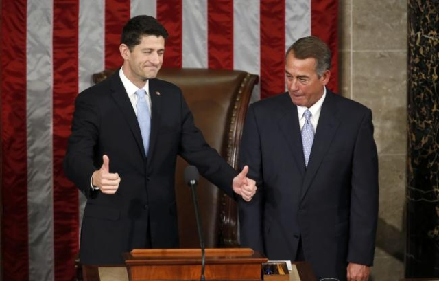 U.S. House of Representives Speaker-elect Paul Ryan, left, gestures as he stands with outgoing Speaker John Boehner after Ryan was elected on Capitol Hill in Washington, Oct. 29, 2015. (Gary Camer ...