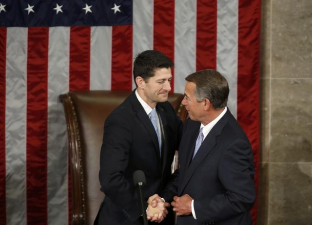 Outgoing U.S. House Speaker John Boehner, R-Ohion, right, greets House Speaker-elect Paul Ryan during the election for the new Speaker of the U.S. House of Representatives on Capitol Hill in Washi ...