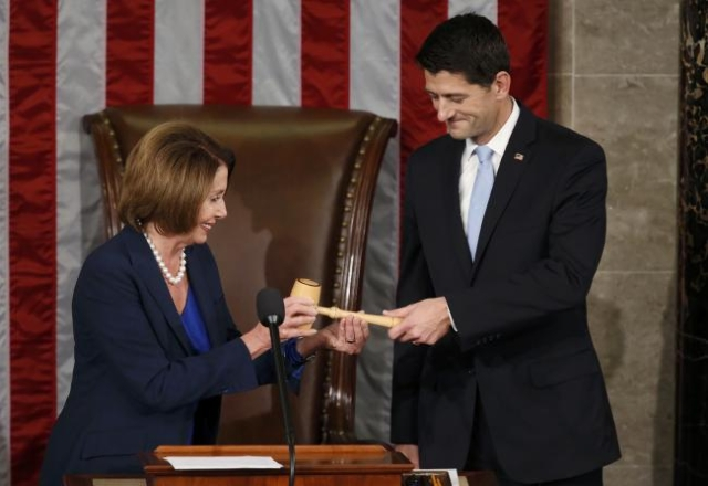 Former U.S. House Speaker and current Minority Leader Nancy Pelosi (L) hands newly-elected Speaker of the U.S. House of Representatives Paul Ryan the gavel during during the election for the new s ...