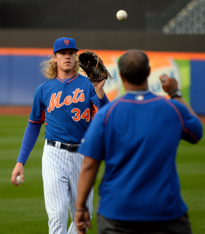 Oct 29, 2015; New York City, NY, USA; New York Mets starting pitcher Noah Syndergaard (34) warms up at the workout day for the World Series game three at Citi Field. Mandatory Credit: Robert Deuts ...