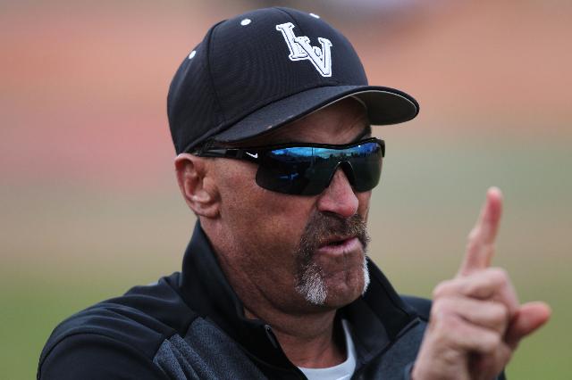 UNLV baseball head coach Tim Chambers signals to his bullpen in their game against Pacific at Wilson Stadium in Las Vegas Monday, Feb. 23, 2015. UNLV won 11-1. (Erik Verduzco/Las Vegas Review-Journal)