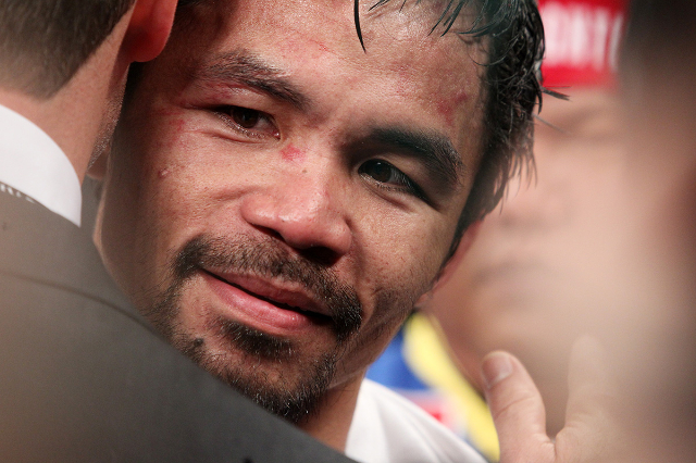 Manny Pacquiao gets a hug after his welterweight unification boxing match against Floyd Mayweather Jr. at the MGM Grand Garden Arena in Las Vegas on Saturday, May 2, 2015. (Sam Morris/Las Vegas Re ...