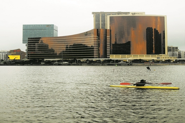 The Wynn Macau hotel, left, and Wynn Encore casino and hotel in Macau April 21, 2010. (Reuters/Tyrone Siu)