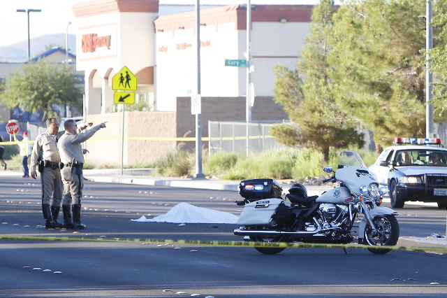 Metro police investigate a fatal auto-pedestrian accident on Maryland Parkway on Wednesday, Oct. 7, 2015. The accident was in a school zone in front of Gehring Elementary School, but it appears it ...