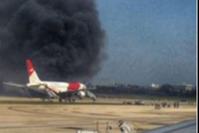 A Dynamic International Airways plane after it apparently caught fire on the runway in Fort Lauderdale, Florida, Thursday, Oct. 29, 2015. (CNN)
