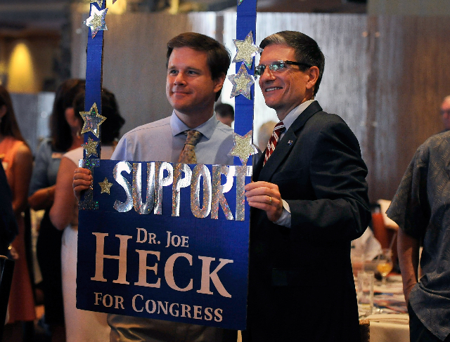 U.S. Rep. Joe Heck, R-Nev., right, poses with Ed Williams during the Nevada Republican Men's Club luncheon at the Bali Hai Golf Course Clubhouse on Monday, Aug. 4, 2014. (David Becker/Las Ve ...