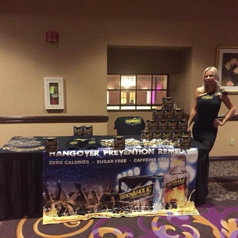 Nicole Johnson stands before a booth representing a hangover prevention product. (Courtesy/Facebook)
