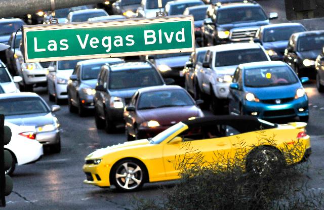 Vehicle traffic travels along the Strip at Tropicana Avenue in Las Vegas on Thursday, Feb. 26, 2015. (David Becker/Las Vegas Review-Journal)