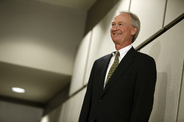 Former Rhode Island Governor Lincoln Chafee waits to go onstage  during an address to the George Mason University (GMU) School of Policy, Government, and International Affairs at their campus in A ...