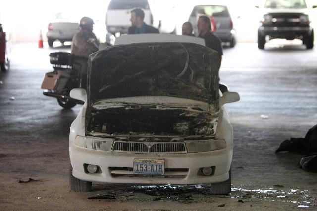 A car caught fire inside a parking garage at the Palms in Las Vegas on Thursday, Oct. 1, 2015. (Erik Verduzco/Las Vegas Review-Journal Follow him @Erik_Verduzco)