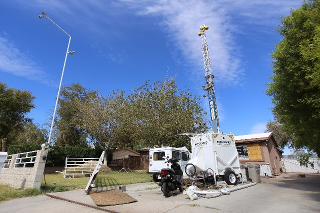 A portable tower of surveillance equipment towers over the home of Rick Van Thiel on Thursday, Oct. 8, 2015 in Las Vegas, where he allegedly performed medical procedures like abortions and cancer  ...