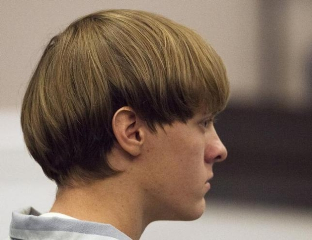 Dylann Roof, the 21-year-old man charged with murdering nine worshippers at a historic black church in Charleston last month, listens to the proceedings with assistant defense attorney William Mag ...