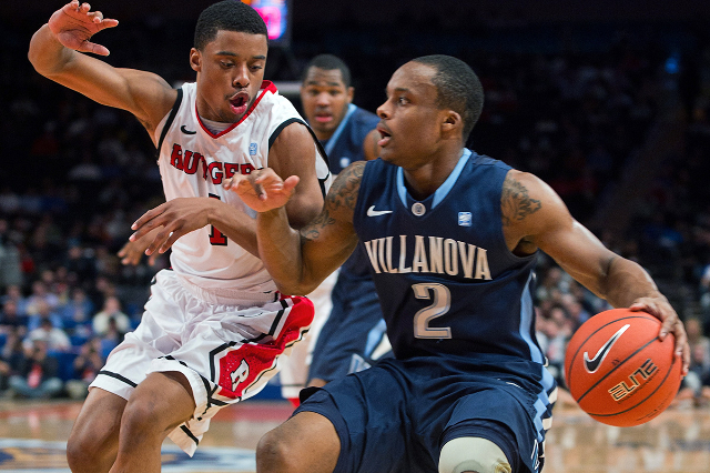 Villanova Wildcats guard Maalik Wayns (2) drives around Rutgers Scarlet Knights guard Jerome Seagears (1) during the first half of their NCAA men's championship basketball game at the 2012 B ...