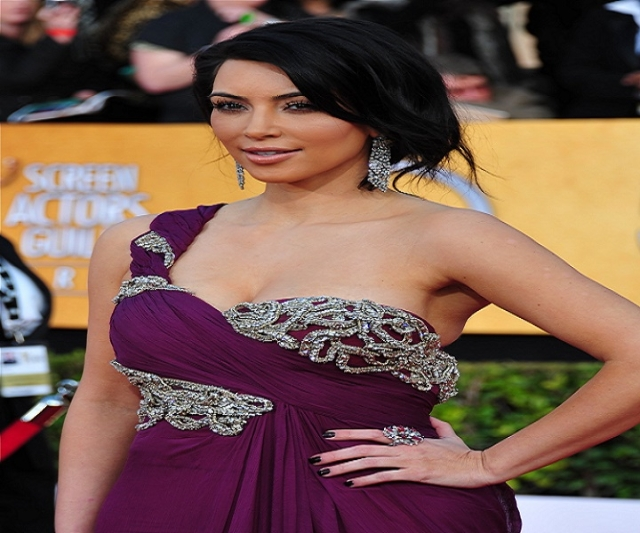 Reality star Kim Kardashian walks the red carpet at the 17th Annual Screen Actors Guild Awards in Los Angeles. (Tom Larson/CNN)