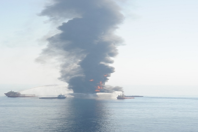 Assist vessels fire water cannons at the Deepwater Horizon in an attempt to control and extinguish a fire April 21, 2010, which has engulfed the mobile offshore drilling unit after an explosion Ap ...