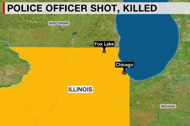 A police officer was shot and killed in Lake County, Illinois, authorities said September 1, 2015. Law enforcement officials searched the area on food and in helicopters looking for multiple suspe ...