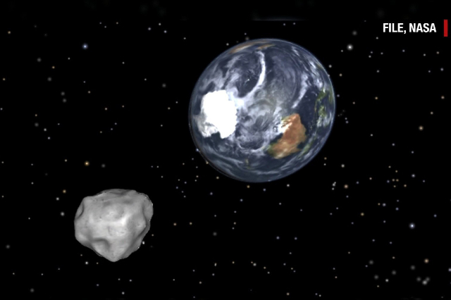 An asteroid, named 2015 TB145, will narrowly miss the Earth by about 300,000 miles (slightly farther away than the moon). (CNN)