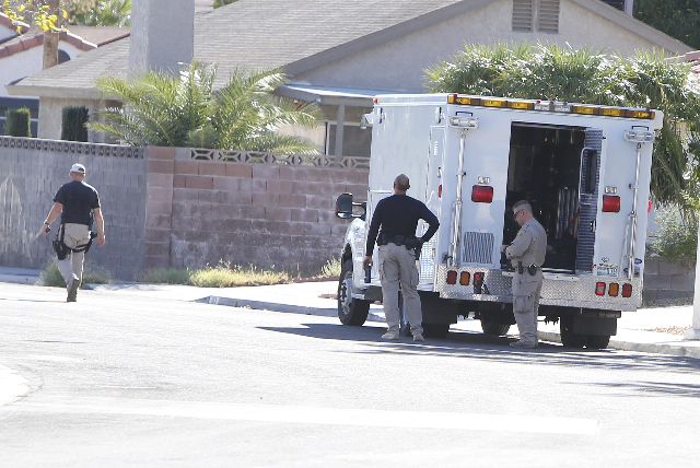 Las Vegas police are investigating a barricade situation where three people are dead after a shooting in a southeast valley neighborhood Friday, Oct. 2, 2015 in the 7200 block of Hardtack Circle,  ...