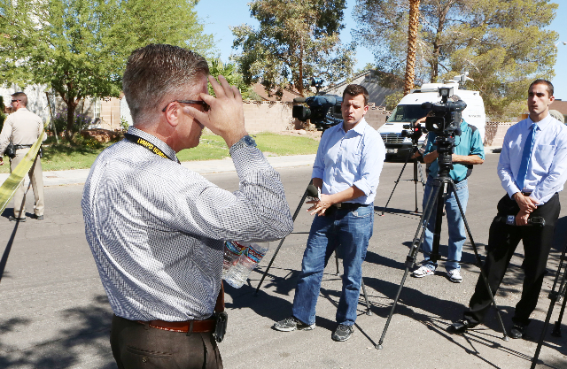 Metro Police Lt. Daniel McGrath talks to the media about a barricade situation where three people are dead after a shooting in a southeast valley neighborhood Friday, Oct. 2, 2015 in the 7200 bloc ...