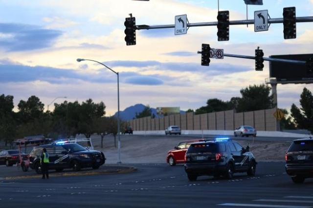 Nevada Highway Patrol officers guide traffic after a power outage knocked out traffic lights in east Las Vegas on Thursday, Oct. 29, 2015.  (Brett Le Blanc/Las Vegas Review-Journal)