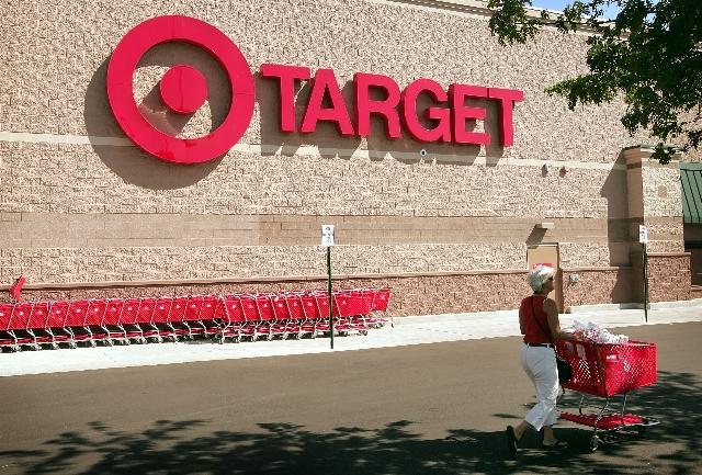 A shopper leaves a target store July 18, 2006. (File)