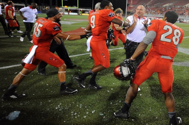 UNLV Rebels head coach Tony Sanchez celebrates his first victory as coach of the Rebels with his players after defeating Idaho State 80-8 at Sam Boyd Stadium. (Stephen R. Sylvanie-USA TODAY Sports)