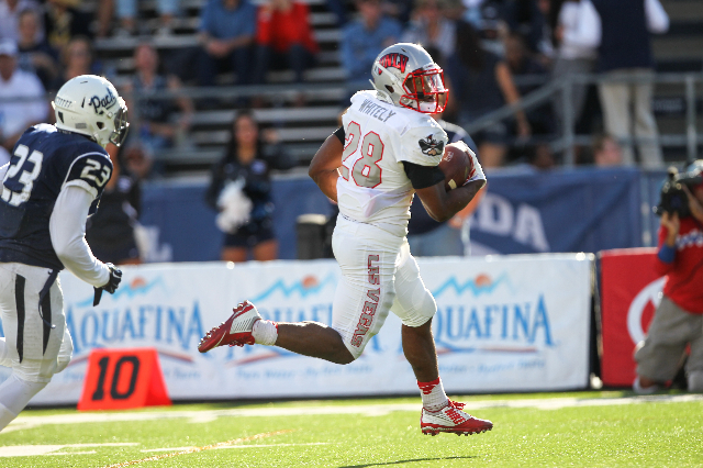 UNLV's Keith Whitely (28) runs the ball for a touchdown in the first quarter of their football game against UNR at Mackay Stadium in Reno, Nev. on Saturday, Oct. 3, 2015. Chase Stevens/Las V ...