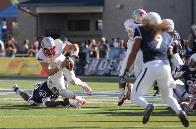 UNLV's Blake Decker (3) runs the ball as UNR's Malik Reed (90 attempts to stop him during their football game at Mackay Stadium in Reno, Nev. on Saturday, Oct. 3, 2015. Chase Stevens/L ...