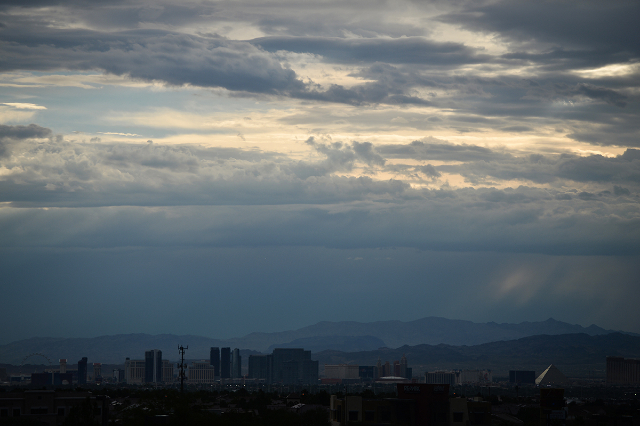 Light peaks through clouds over the Strip after light rain on the morning of Friday, Oct. 16, 2015. (Brett LeBlanc/Las Vegas Review-Journal Follow @bleblancphoto)