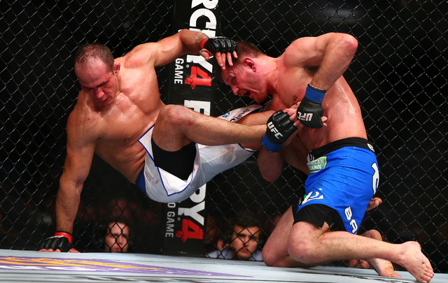 Stipe Miocic, right, brings down Junior Dos Santos during UFC Fight Night at US Airways Center in Phoenix. (Mark J. Rebilas-USA TODAY Sports)