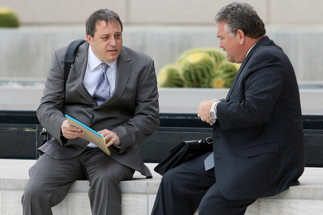 Local attorney Barry Levinson, left, speaks with his attorney Brent Bryson before going into Lloyd George U.S. Courthouse for sentencing Friday, May 22, 2015, in Las Vegas. (Ronda Churchill/Las Ve ...