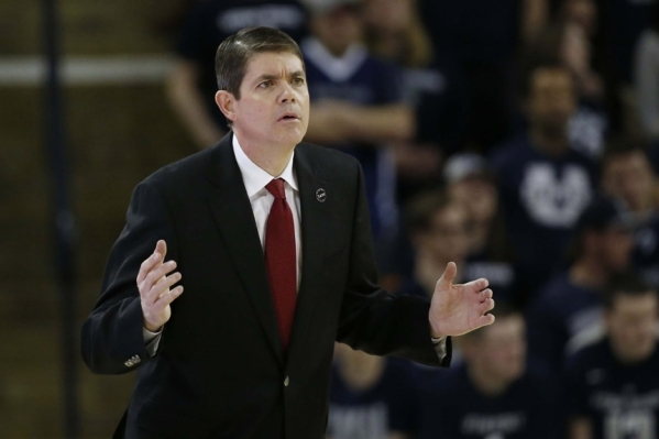 Feb 24, 2015; Logan, UT, USA; UNLV Rebels head coach Dave Rice reacts to a call in the first half against the Utah State Aggies at Dee Glen Smith Spectrum. Mandatory Credit: Jeff Swinger-USA TODAY ...