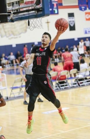 Mo Williams Elite team member Skylar Mays (11) shoots a basket during the Fab 48 tournament basketball game at Bishop Gorman Catholic High School at 5959 South Hualapai Way in Las Vegas on Friday, ...