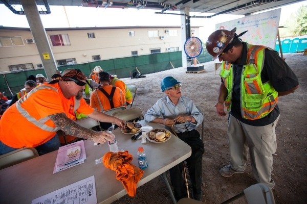 "Construction worker Kenny Stepuchin, right, talks with Miguel, last name declined, after the ""topping off"" ceremony at the Lucky Dragon hotel-casino in Las Vegas on Friday, Sept. 11, 201 ..."