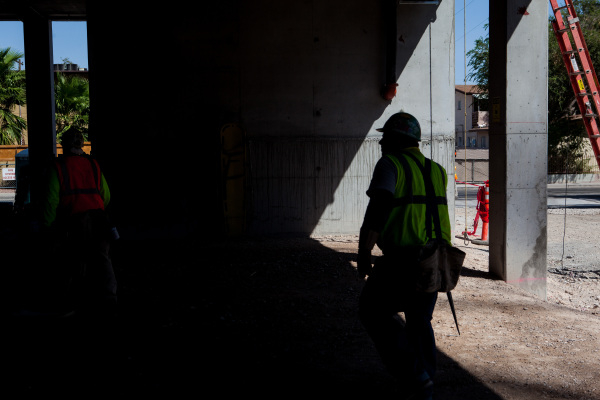 "Construction workers gather before the ""topping off"" ceremony at the Lucky Dragon hotel-casino in Las Vegas on Friday, Sept. 11, 2015. Chase Stevens/Las Vegas Review-Journal Follow @csst ..."