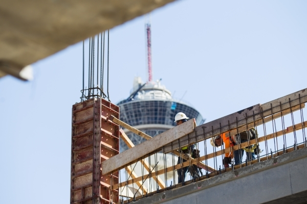 Construction workers, with the Stratosphere hotel-casino in the background, make progress on the Lucky Dragon hotel-casino in Las Vegas on Friday, Sept. 11, 2015. Chase Stevens/Las Vegas Review-Jo ...