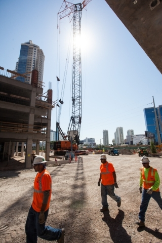 "Construction workers pass by before the ""topping off"" ceremony at the Lucky Dragon hotel-casino in Las Vegas on Friday, Sept. 11, 2015. Chase Stevens/Las Vegas Review-Journal Follow @css ..."