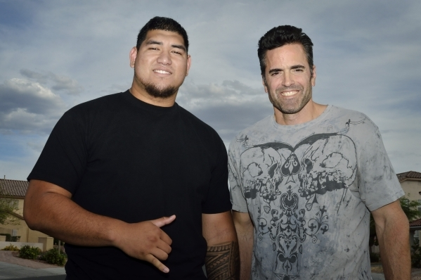 Jeremiah Poutasi, left, is shown with his high school guidance counsellor Sean Abid in front of the Poutasi home near East Washington Avenue and Hollywood Boulevard in Las Vegas on Friday, May 1,  ...