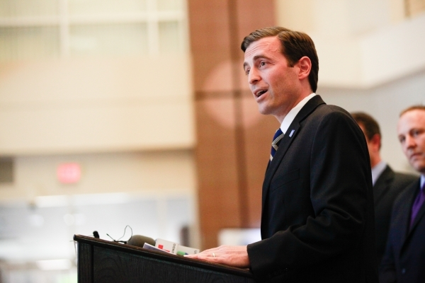 Nevada Attorney General Adam Laxalt speaks with news media at the Sawyer Building in Las Vegas on Tuesday, April 28, 2015.  (Chase Stevens/Las Vegas Review-Journal)